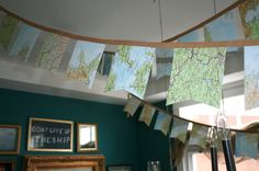 DIY garland: cut desired shapes out of paper, place inside seam binding and sew together