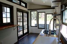 French doors and large windows - Wind River Tiny Homes