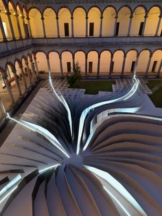 "As part of last month's Milan Design Week, Zaha Hadid Architects teamed with LEA Ceramiche to create ""Twirl,"" a mesmerizing temporary installation in the 18th-century courtyard of the State University in Milan."