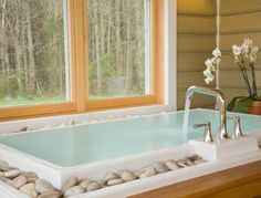 Like the idea of the river stones around the infinity tub. Don't like the faucet in the middle tho