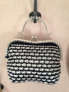 A black and silver purse made from sida tabs