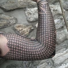 Nissaco's tattoo work rides the crosshairs of optical illusion and reality // ##blackwork #blackandgrey #tattooist #tattooart