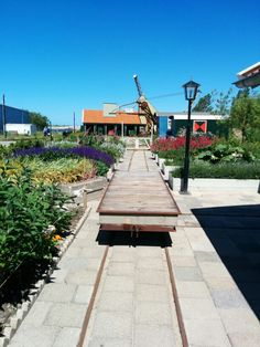 Plants and flatbed train wagon feature in the station garden at the Nationaal Smalspoormuseum in Katwijk, The Netherlands.
