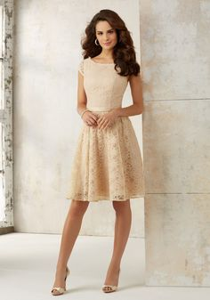 Chic Knee Length Lace Bridesmaids Dress Featuring a Matching Satin Waistband and Open Keyhole Back. Zipper Back. Shown in Champagne and Bordeaux