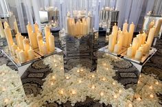 candle displays surrounded by flower petals and mirrored containers to create even more abundance