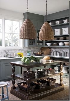 Prep Kitchen - There is a not a ton of storage space in the 'main kitchen', but I think that is just awesome.  Why clutter your everyday space with rarely used turkey roasters and extra pots and pans when you can store them in your…  Prep kitchen…  with custom island built by The Gilded Stag