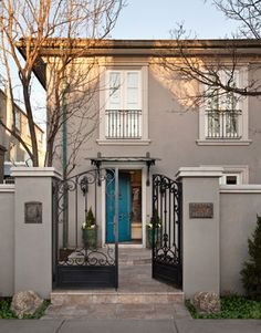 I like the turquoise door with the darker grey, with creamy white and black accents