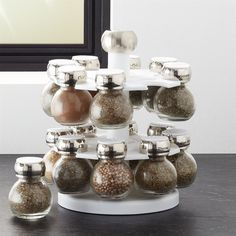 Crate & Barrel Revolving Spice Rack with 16 Jars ($25) ❤ liked on Polyvore featuring home, kitchen & dining, food storage containers, crate and barrel spice jars, crate and barrel, crate and barrel jars and crate and barrel spice rack