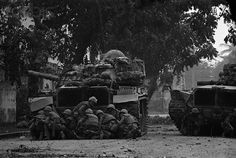 https://flic.kr/p/6F2yT9   BE052696   01 Feb 1968, Hue, South Vietnam --- 2/1/1968-Hue, South Vietnam- US Marines take cover behind a tank in Hue 2/1 after Viet Cong terrorists snipers opened fire on them. The Marines, along with the South Vietnamese troops, were battling an estimated 2,000 Viet Cong who occupied parts of this ancient, Imperial city. --- Image by © Bettmann/CORBIS