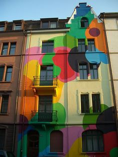 Nice group of colors! goo.gl/33uo5 architectur, paint hous, color, painted houses, amaz colour, street art, house art, balloon, rainbow