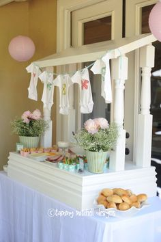"""baby shower with onesies appliqués with baby's initials, butterfly favors, and a big """"S"""" with fantastic buttons applied. Perfect for bay's wall. Easy to build display for a 6' table. Many great ideas."""
