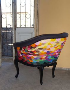 Rococo style chair is reupholstered with felt circles in a rainbow of colors. Love it!