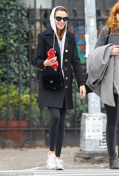 Trendy in training: Alexa Chung looked happy as she emerged from the gym following a ballet class in New York on Wednesday