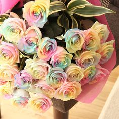 rainbow roses, how do you not love them? They could only be prettier dipped in crystals.