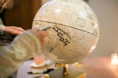 Loving this idea of having your guests sign a globe instead of a guestbook! Captured by Jessica Gold Photography #bridesofnorthtx #wedding #guestbook