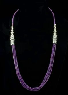 """Purple Turquoise Heshi Necklace  Five strands of genuine Turquoise dyed to a beautiful purple color. Hand made sterling silver barrel beads and round beads with southwestern design. Necklace is 25"""""""" and signed by the Native American artist.   http://www.sterlingjewelrystores.com/sterling-silver-Purple-Turquoise-Heshi-Necklace.html"""