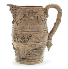 An important brown stoneware jug by Robert Brettingham De Carle, dated 1781   Robert Brettingham De Carle came from a family of masons and sculptors from East Anglia. He is also thought to have worked for Mrs Coade's artificial stone factory at Lambeth. Only a small number of his wares are recorded, characterised by high quality modelling in high relief, turning utilitarian brown stoneware into a luxury product. The earliest recorded example is a harvest jug of different form inscribed 'R B…