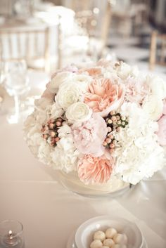 White and blush wedding centerpiece.