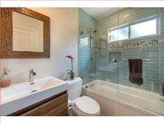 Small shower? Add some color to make the room pop!