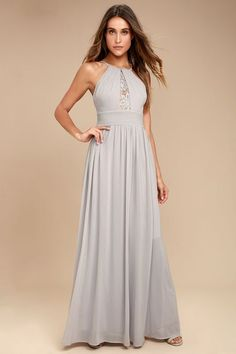 Get swept away in the Cherish the Night Grey Lace Maxi Dress! Dreamy Georgette sweeps down from adjustable skinny straps into high, pleated halter neckline with a crochet lace inlay. A fitted, pintucked waistline flows into a full maxi skirt. Hidden back zipper/clasp.