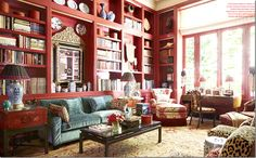 Love the red with the blue in this living room