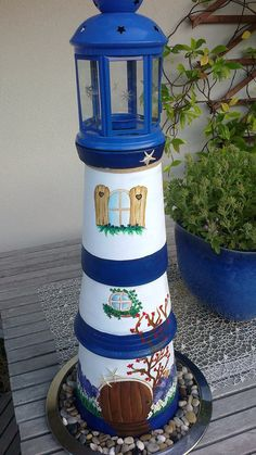 Clay pot lighthouse for yard