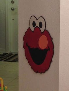 Pin the nose on Elmo. Savvy and Sassy: Girly Elmo 2nd Birthday Party