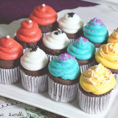 Mini cupcakes in red, teal, white and yellow. Go cupcakes!