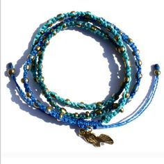 """Ketzali Wachinik Handmade Bracelet 3in1 Ketzali Wachinik Handmade Bracelet """"3in1"""" in Blue, Aquamarine & Turquoise with Bronze Metal Beads. Each bracelet has a different animal charm.  26"""" round, 100% Waxed Polyester Thread & Metal Beads.  These bracelets are handmade by skilled artisans in Guatemala. Each bracelet is made with care and dedicated skill and is one of a kind!!  NO TRADES Free Beauty Sample With Purchase  Ketzali Jewelry Bracelets"""
