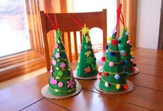 The girls made these little Christmas Tree gift boxes for Emily's teachers this week. They were similar to the advent Christmas trees bu. Ribbon On Christmas Tree, Christmas Tree With Gifts, Little Christmas Trees, Christmas Deco, Kids Christmas, Christmas Ornaments, Winter Crafts For Kids, Sunday School Crafts, Christmas Centerpieces