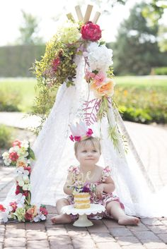 One year girl boho mini naked cake smash cake session with floral tee pee and crown