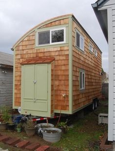 The 248 Sq. Ft. Lilypad Tiny House on Wheels includes two lofts, two staircases, as well as a kitchen, bathroom, bedroom, office, and living room. | Tiny Homes