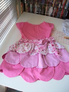 this makes me want to pull out the sewing machine! my spin on a petal dress I seen on Pinterest