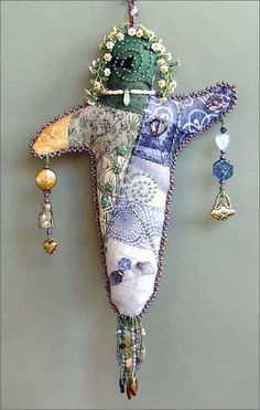 beaded spirit doll by Robin Atkins, bead artist love the spiral for the face- Brilliant Robin Atkins!!