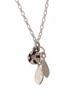 Small Silver Mānuka Seed Pod with A Garnet set inside the pod to give a hint of Red. Two small sterling silver leaves hang below the seed pod. Sterling Silver Fine Sterling Silver Chain Standard is , available in all sizes Pod x Leaf Necklace, Pendant Necklace, Jewellery Nz, Seed Pods, Sterling Silver Chains, Garnet, Seeds, Handmade Jewelry, Pendants