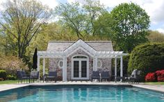 A spectacular property in New Canaan, CT with heated pool, pool house, and greenhouse on 7.5+ acres.