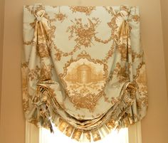 Toile fabrics, especially with centered motifs are beautiful in this type of treatment. designNashville custom draperies