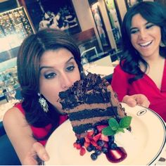 Lauren and Joelle enjoy some delicious chocolate cake from NYY Steak!