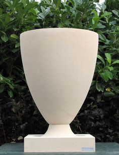Nichols Bros. dry-cast limestone reproduction Frank Lloyd Wright American Systems Built Houses vase from Detroit Garden Works.