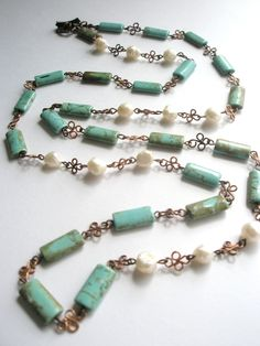 Gemstone Necklace,Turquoise, Fresh Water Pearls and Copper Long Necklace. $65.00, via Etsy.