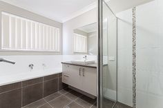 mocha bathroom brown floor and bath with white tiles in shower