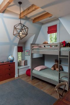 Both boys room are furnished in a similar fashion with the same paint colors and trim, giving continuity to the home. Christopher Architecture and Interiors