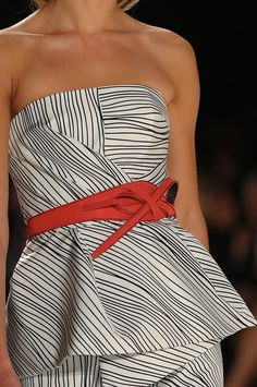 Carolina Herrera.  I LOVE this.  Black, white and a red leather belt.  TRULY FABULOUS.