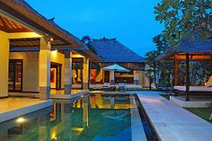 Villa Cinta - fuses modern contemporary design with Balinese ethnic and emphasis on traditional Indonesian architecture; with its little Hindu temple wrapped in saffron robes Villa Cinta