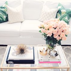 Coffee table styling, Tom ford, chanel, banana Palm pillow, gold coffee tAble, table books