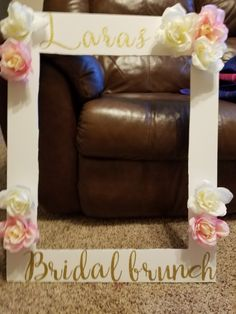 Diy photo frame prop for bridal brunch. Stick on letters bought from Hobby Lobby. Use a hot glue gun to attach flowers.
