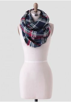 Soft and luxurious, this wool-blend infinity scarf is perfected in a red, blue, and cream-colored plaid pattern. Finished with a raw-edged hem, this lovely scarf is ideal for wearing on those crisp fall days.<br /> <br /> 30% Wool, 70% Acrylic<br /> Imported<br /> 30.5
