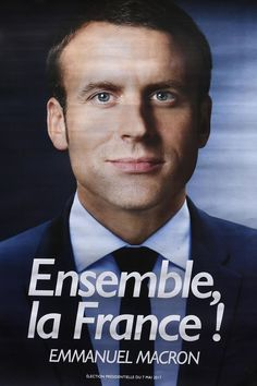 An electoral poster of French presidential election candidate for the En Marche ! movement Emmanuel Macron is displayed at a warehouse in Gonesse, north of Paris on April 26, 2017, ahead of the second round of the presidential election. / AFP PHOTO / Lionel BONAVENTURE