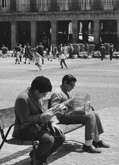 André Kertész, Madrid (man reading and young man with birdcage) 1971