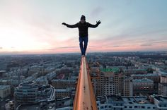 Since this man is skywalking, he may have lesion in his amygdala because he does not seem to be experiencing fear at this height. While most people would be afraid to walk on a thin surface at this height, the lesion in his amygdala may account for this lack of fear.